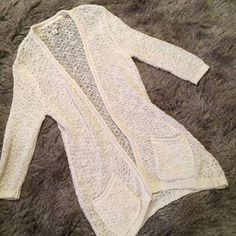 """Long cream loose knit cardigan This sweater is a very loose knit sweater. Two pockets on the front. 3/4 length sleeves. L:34.5"""", B:19.5"""", S:20.5"""". Ruff Hewn Sweaters Cardigans"""