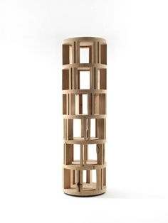 Bookshelf made from a single block of scented cedar with a linear column design and different levels that create space for the container compartments. Revolving Shoe Rack, Revolving Door, Bookcase Wall Unit, Bookshelves, Wall Units, Unique Furniture, Contemporary Furniture, Column Design, Door Accessories