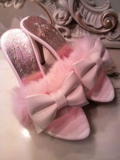 Oh. Here's my pretty Pink slippers. I always seem to lose my Pink shoes. they are everywhere around the house. I like to go barefoot, so I take my shoes off every chance I get.....................