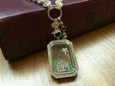 """Origami Owl Silver Classic Heritage Locket, 18""""-20"""" Silver Double Link Custom Chain, and Small Silver Tassel. Charms: Limited Edition Nativity, LE 2014 Snowflake, and Turquoise Stardust Crystals."""