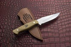 """Marsico - Denis Mura - Steel 440C 5mm (0.19"""") Total length 22 ,5 cm (8.8""""). Blade length 11cm (4.3"""").  Handle micarta old ivory and red spacers. Taper tang. Scrimshaw by Andrea Longagnani. Sheath by Kiara"""