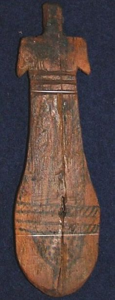 Oldest doll: Egyptian paddle doll  Date: 2000 BCE