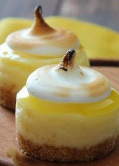 Mini Lemon Meringue Cheesecakes - A fun recipe for mini lemon meringue cheesecakes, featuring lemon cheesecakes topped off with fresh lemon curd and meringue frosting. A perfect bite sized Spring dessert!..