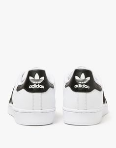 4b34b5d809fce4 adidas Originals Superstar Trainers in White and Core Black.