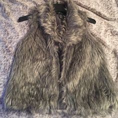 VON MAUR faux fur vest Adorable gray and black faux fur vest! Silk-like inside lining. Super cute, great condition. Ask for pics if you'd like to see it on. Jackets & Coats Vests