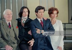 Irish actor Pierce Brosnan poses with his co-stars Desmond Llewelyn (left), Famke Janssen (second from left) and Izabella Scorupco (right) during a publicity shoot for the James Bond film 'GoldenEye', UK, 22nd January 1995.
