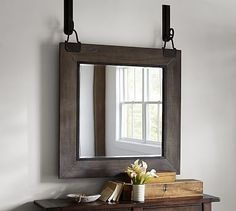 """Fun way to hang a mirror. Carleton Mirror #potterybarn, Overview  Because of the handcraftsmanship visible in the frame's distressed finish and the carefully rubbed scrolled hooks, each of our Carleton Mirrors is one of a kind.  •40"""" wide x 48.75"""" high x 4.25"""" deep •MDF frame with wood veneer. •Distressed dark brown stained finish with grey tones. •Iron hardware with a bronze finish. •Beveled glass mirror. •Mounting hardware included. •Catalog / Internet only"""