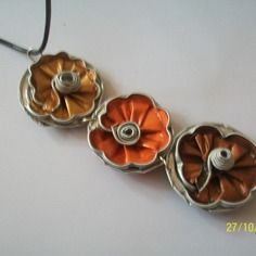 Pendentif en capsule nespresso  trois jolies fleurs