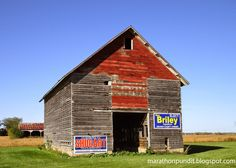 Old barn with campaign signs near Morris, Illinois
