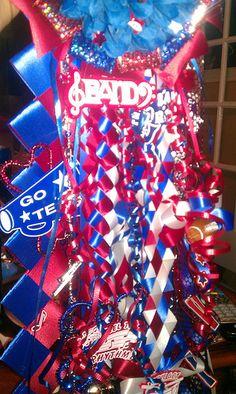 Homecoming mums with military braid, victory braid, diamond braid and multi loop ribbon.