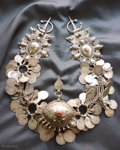 wonderful set of Molded fibulae with connecting chains laden with coins and a central coral set pendant in the form of an eye. Rif region in Northen Morocco Circa 1930 Fibulae cm x cm Chains 14 cm Pendant 10 cm x 18 cm 960 grams African Jewelry, Tribal Jewelry, Indian Jewelry, Silver Jewelry, Ancient Jewelry, Antique Jewelry, Vintage Jewelry, Handmade Jewelry, Collar Hippie