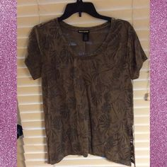 DKNY Sheer Green Top DKNY Sheer Green Top. This Top is NWOT. Never been worn. It is sheer. It is a size medium. Very pretty. DKNY Tops Tees - Short Sleeve
