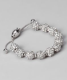 Break out the bling: This chic bracelet is detailed with shimmering pavé orbs and a delicate chain that adjusts for a comfortable fit. Adjustable from 5'' to 9.5'' circumference.