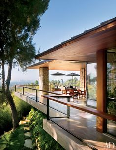 Shadley extended the eaves, which were clad in cumaru, and put in travertine flooring. Umbrellas are from Janus et Cie.