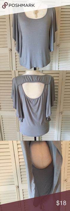 """B Leev Gray Tunic Size Medium Beautiful gray Top with shoulder Ruffles to waist.  GUC See Measurements below.  Fabric is a Poly Spandex blend.  Bust:  36 1/4"""" Length:  24""""  🦋🦋🦋🦋🦋🦋🦋🦋🦋🦋🦋🦋🦋🦋 B Leev Tops Tunics"""