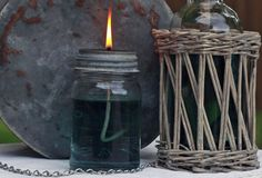 Use a Mason jar and olive oil to make a simple lamp. Loving this!