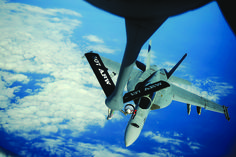 A KC-135 Stratotanker delivers fuel to an F/A-18F Super Hornet assigned to the Black Knights of Strike Fighter Squadron 154 supporting Rim of the Pacific exercises in 2010.
