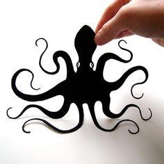 Octopus papercut mounted on white board