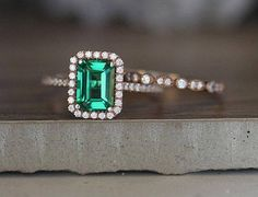****Engagement Ring Details****  14k Solid Rose Gold (Also can be made in White and Yellow Gold, Please select your choice At Checkout) 1.5-1.6mm (Approximate Band Width) Lab Created Emerald Emerald Cut 8x6mm 1.40carats (Average Weight of Center Gemstone) VS1 Absolutely Clean (Clarity)
