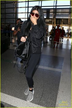 kylie jenner tyga coordinate outfits at lax airport 01