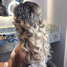 Gorgeous flowing waves accented with a glimmering crystal hair vine from Bridal Styles Boutique. #downdo #weddinghair #bridalheadpiece