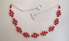 Beaded choker with flowers in ruby red super duo by JoolsbyAveril