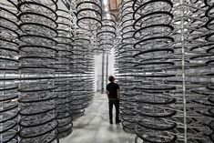 """""""Stacked"""" by Chinese artist Ai Weiwei is an installation of 760 bicycles arranged into a monolithic structure. The installation is part of an Ai Weiwei"""