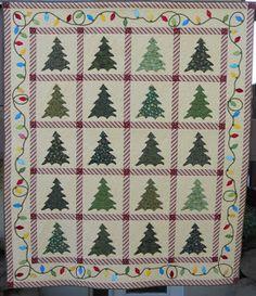 Quilt2sr5: Christmas Tree Quilt. Love the border of lights!