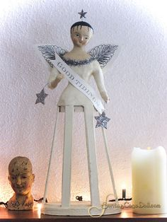 Folk art cage doll angel made from wood, plaster and paper pulp.  Pretty.