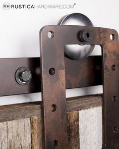 Bootstrap barn door hardware with a warehouse bronze finish.  http://rusticahardware.com/boot-strap-barn-door-hardware/