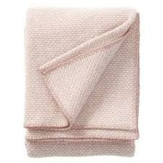 Domino Pink Wool Throw ($88) ❤ liked on Polyvore featuring home, bed & bath, bedding, blankets, wool throw, wool bedding, wool blanket throw, pink blanket and wool throw blanket