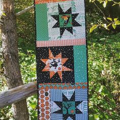 My wonky star Halloween table runner with spiral quilting. Made with Witch Hazel fabrics by Riley Blake.