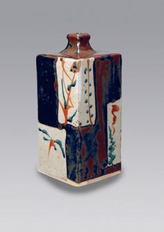 人間国宝 濱田庄司展 = Shoji Hamada : Press-molded bottle vase, cream and tenmoku chequered pattern featuring bamboo and foliage design.