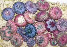 Tandletons: tatted, needle lace and embroidered buttons. This is a class that I teach embroidering a base with threads and silk ribbon.