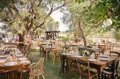 I like the mismatched chairs thing. Gives character to an othewise stuffy affair....I wonder if there's anywhere we could rent this kind of thing from? hmmm Rochelle and Gordon's Rustic Outdoor Wedding