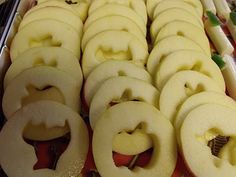 Apple slices with the cores removed using mini cookie cutters. Serve with caramel dip for Halloween party