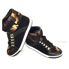 MICHAEL KORS SNEAKERS Camouflage fur on a black sneaker with gold accents.  NWOT Michael Kors high top sneakers. Final price  Michael Kors Shoes Sneakers