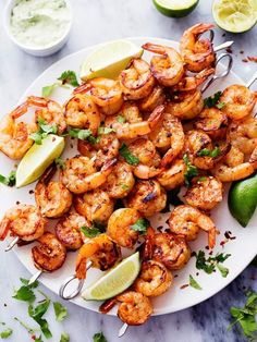 Try this recipe for grilled spicy lime shirmp with creamy avocado cilantro sauce for a lighter, keto-friendly summer barbecue option. #seafoodrecipe #shrimp #keto #ketorecipe #ketofriendly