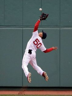 Boston Red Sox center fielder Mookie Betts catches a deep fly ball by Toronto Blue Jays' Devon Travis in the third inning of a baseball game at Fenway Park in Boston, Wednesday, April 29, 2015. (AP Photo/Elise Amendola) Boston Red Sox Team Photos - ESPN