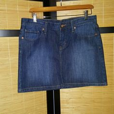 Gap jean skirt NWOT Cute jean mini skirt,never worn, cute detail on back pockets no returns or trades can bundle or offer GAP Skirts Mini