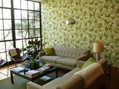 Love the wallpaper and the wall of windows.  Cool couches too.