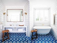 White bathroom stand alone tub subway tile blue cement tile floor brass plumbing faucet cococozy halcyonhouse blackandspiro Cement Tiles Bathroom, Best Bathroom Tiles, Bathroom Stand, Bathroom Tile Designs, Bathroom Flooring, Small Bathroom, White Bathroom, Bathroom Ideas, Bathroom Bath
