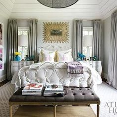 Atlanta Homes & Lifestyles - bedrooms - gray, walls, gray, silk, pinch-pleat, drapes, white, iron, bed, white, pink, monogrammed, shams, gray, rug, white, lamps, turquoise, blue, vases, photography, art, gray curtains, gray silk curtains, turquoise accents, gray bench, gray tufted bench, gray french bench, B.D. Jeffries Mirror, B.D. Jeffries Bench,