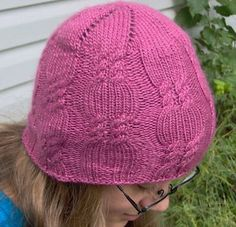 """This easy to knit, unique, top-down hat uses only one 120 yard skein of worsted weight yarn. I designed it as the result of a challenge to """"make a sample"""" from the touch-ably, soft new Silk & Merino yarn at my LYS. It has a beautiful spiral at the top and easy, double cable twists that look like candy wrappers. #giftalong2014"""