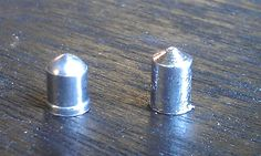 Casting and Swaging your own airgun Pellets. Looks to be a great mould and swager, you can make steel bb tipped ones too. Airguns are a great item to have, especially in the .22 and .25 caliber range. You can get muzzle velocity nearly as good as a bullet, and if you can make your own pellets and have a decent supply of lead from old wheel weights etc you have a good way to hunt small game pretty much indefinitely. Air Rifle, Survival Weapons, Lead Molds, Weights, Blacksmithing, Bb, Range, Bullet, Muzzle Velocity