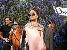 Rihanna stole the show at a Dior event, flaunting a statement fur coat 'n' oversized aviator sunnies with flash lenses!