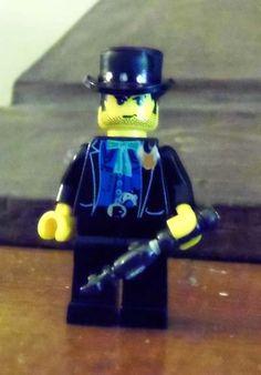 "Detective Inspector Thaddeus ""Brick"" Madley, Lego style."