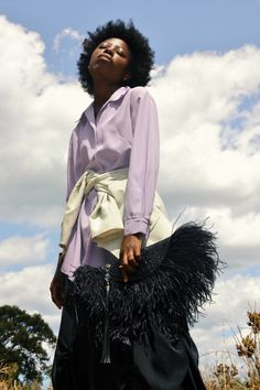 The most divine half moon ostrich feather bag you could come across. Made of Sustainably sourced ostrich feathers from The Karoo of South Africa and ethically handmade in Cape Town