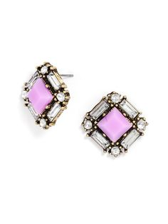 Neon acid-colored jewels shine among tinted crystals for playfully edgy approach to a classic gemstone stud earring.
