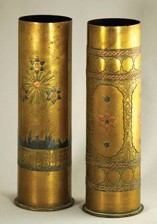 Capper artillery shell casings decorated with copper sun, stars, the Ten Commandments tablets and the skyline of Jerusalem. Description from copper.org. I searched for this on bing.com/images